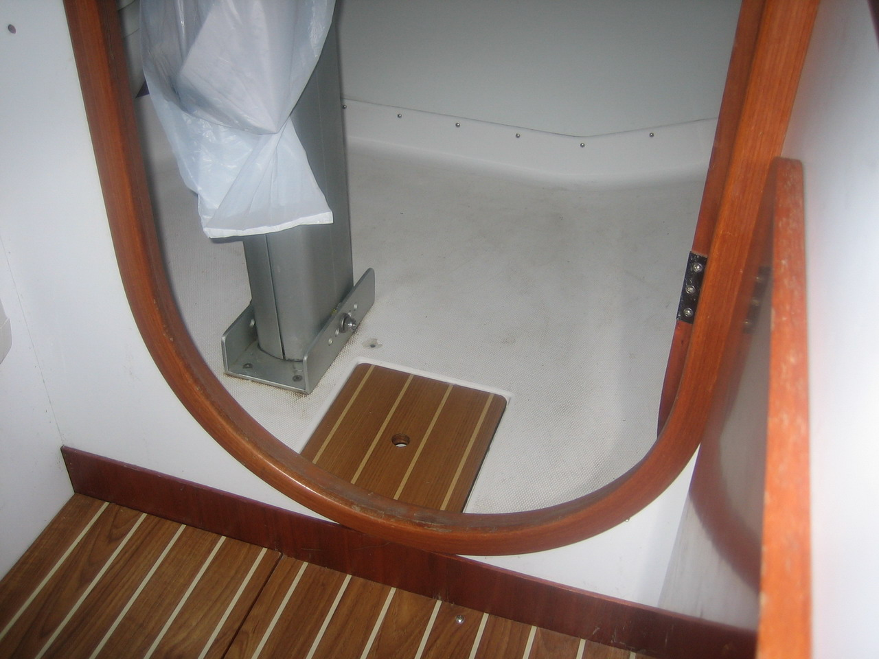 The J105 mast step viewed from the main cabin. The sea toilet and ...