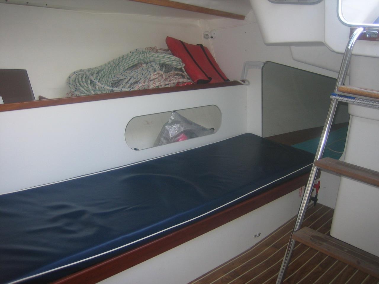 105, the starboard side main cabin berth. Below the companionway ...